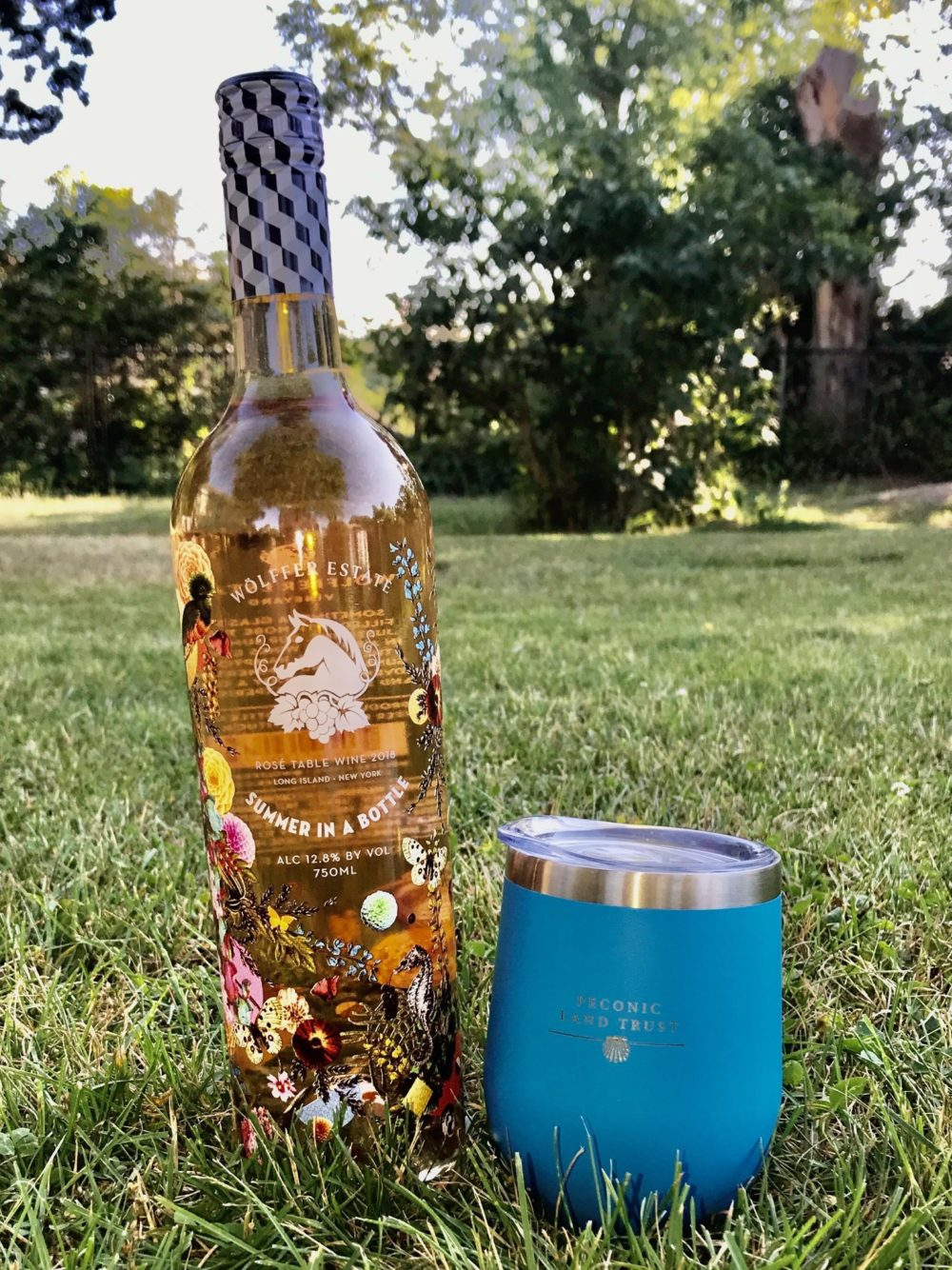Wolffer Estate 'Summer in a Bottle' Rose next to a Peconic Land Trust Tumbler